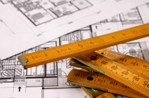 Architecture planning of interiors with metre, metre is on focus